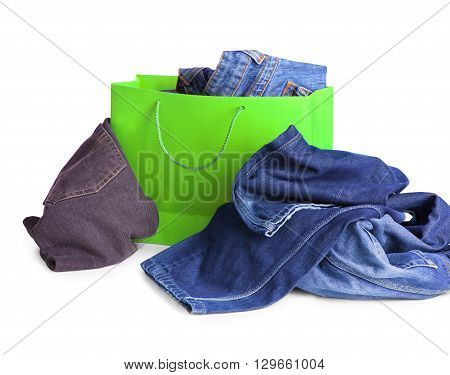 Jeans in the shopping bag on white