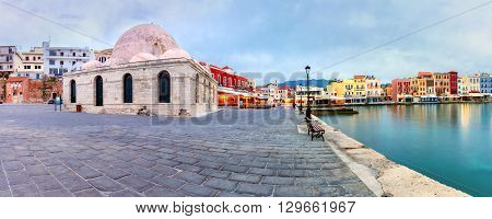Picturesque panoramic view of Venetian quay of Chania with Kucuk Hasan Pasha Mosque during cloudy morning blue hour, Crete, Greece poster