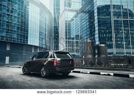 Moscow, Russia - November 22, 2015: Premium car Land Rover Range Rover standing near modern building in the city at daytime