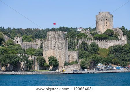 ISTANBUL TURKEY - JULY 29 2015 : Rumeli Fortress on the Bosporus waterfront Istanbul Turkey. Rumeli Fortress one of the most popular locations on the Bosphorus.