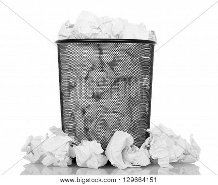Black office bucket full of paper isolated on white background