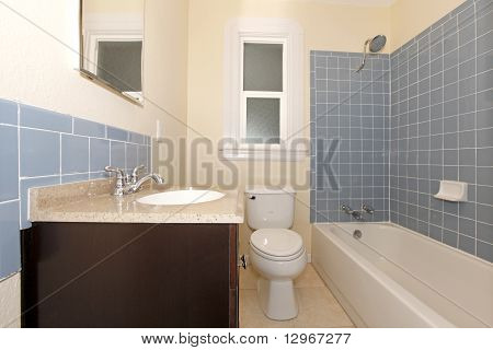 Blue Tiles In Bathroom With Dark Cabinet And Yellow Walls