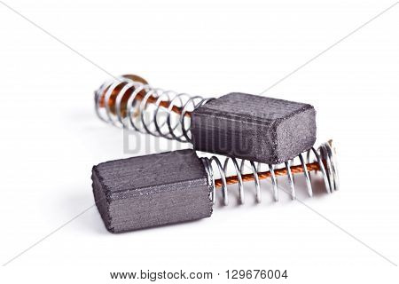 The electro-conductive graphite brushes electric current to the collector of the motor on a white background