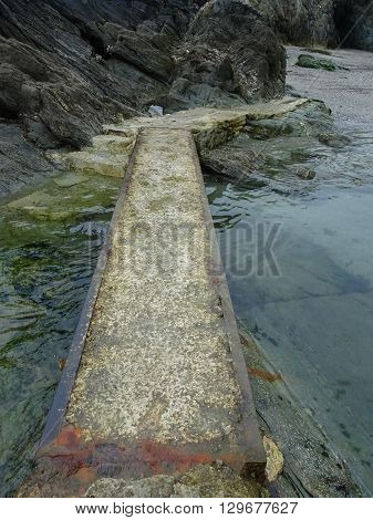 Rocky Causeway Upon Beach Seascape Photographed At Polperro In Cornwall