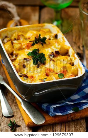 Baked pudding with pumpkin and mushrooms. Selective focus