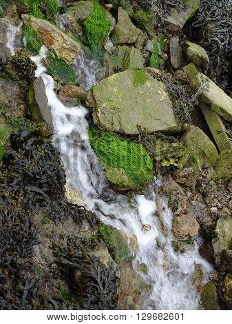 Beach Waterfall Photographed At Looe In Cornwall