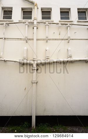 Exterior Water Pipes On An Outside Building