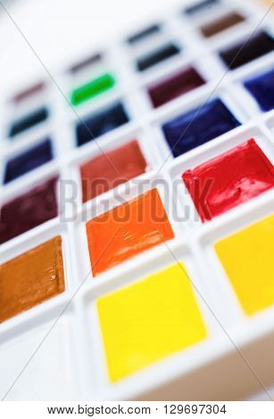 Closeup of watercolor paint palette, close up