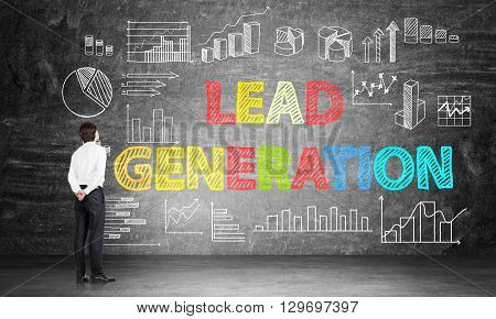 Lead generation concept with businessman looking at business chart and diagrams on chalkboard