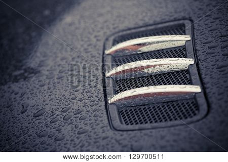 Color image of an air intake scoop on a car.