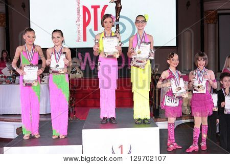 MOSCOW - MARCH 19: Unidentified children age 8-18 awarding at artistic dances at European Artistic Dace Championship, organized by World Dance Artistic Federation on March 19, 2016, in Moscow.