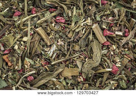 Closeup background of a Breathing and bronchitis herbal tea including ginkgo tea, lemon balm, lemon peel and green rooibos