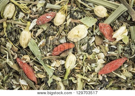 Closeup background of an immune system herbal tea including chrysanthemum and jasmine flower, lemon grass, ginko tea,, Buddha tea, wolfberry and balsam pear.