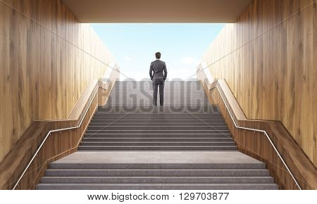 Success concept. Business man climbing stairs leading to success in business. Successful man standing on top of career stairs. 3D Rendering