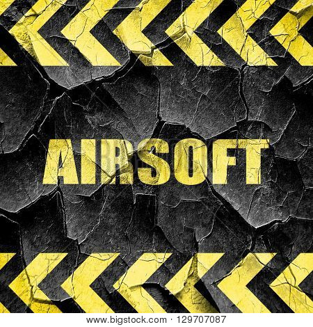 airsoft sign background, black and yellow rough hazard stripes