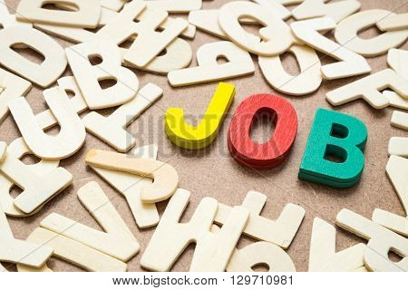 Colorful Job wording - text uppercase letter made from wood mix with other wooden alphabet - concept of job hunting