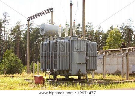 The powerful high-voltage transformer on city substation poster