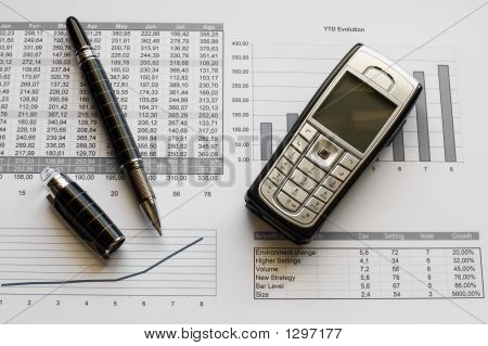 Pen And Mobile Over Financial Data