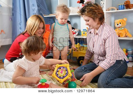 two mothers and children in playroom