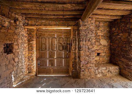 Internal view of a secured door of a grain store (Agadir) in south Morocco.
