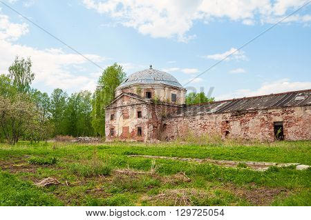 The ruins of the old abandoned farmstead in the overgrown park