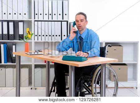 Disabled Business Man In Wheelchair Calling