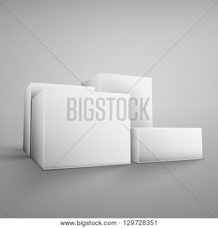 Cardboard white boxes isolated on grey background