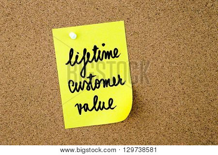 Lifetime Customer Value Written On Yellow Paper Note