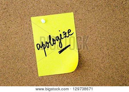 Apologize  Written On Yellow Paper Note