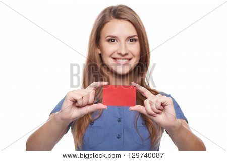 Confident smiling business woman female showing blank credit card, over white background. Shallow depth of field, focus on credit card.