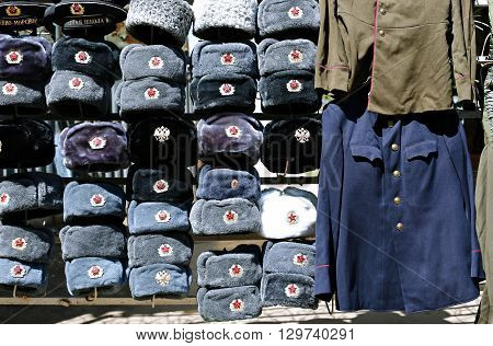 MOSCOW, RUSSIA - MAY 7, 2016: Many multi-colored military hats Soviet and Russian army and navy and outdated military uniform