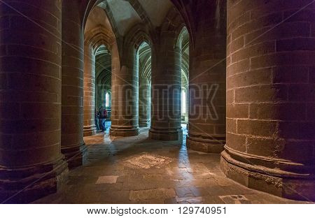 Mont St. Michel France - May 22 2012: Normandy tourists in the crypt of the abbey.