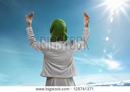 Back View Of Muslim Woman Praying