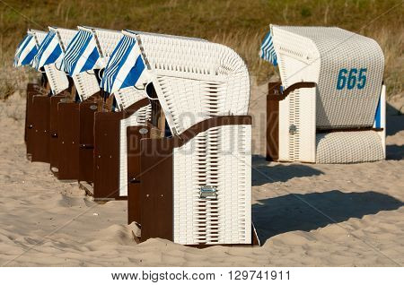 Strandkorb Beach chairs on beach at Binz seaside resort on Rugen Island in Germany poster