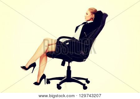 Business woman resting on wheel chair