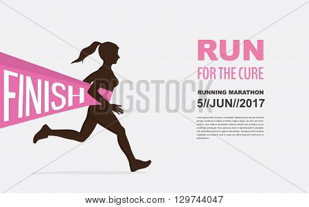number one winner at  a finish  line. breast cancer awareness. run for a good cause