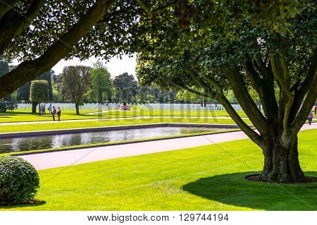 Colleville Sur Mer France - May 23 2012: Normandy visitors walking in the American Cemetery of the second World War.