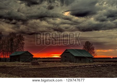 The sun sets late in the spring nights and colors the barns and the fields beautifully. The summer is almost here in the Northern Finland.