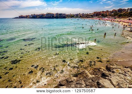 SOZOPOL - AUGUST 11: people on the sea beach on August 11 2015 in Sozopol Bulgaria. Sea beach full of people in high season in Bulgaria