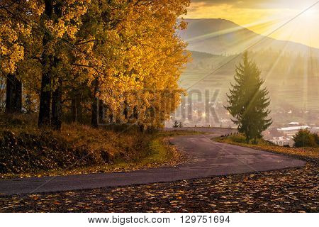 Mountain Road To Village In Mountains At Sunset