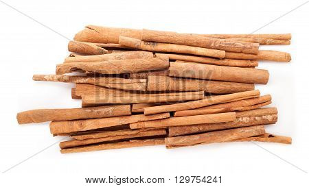 Raw Organic Cinnamon sticks (Cinnamomum verum) isolated on white background. Top view.
