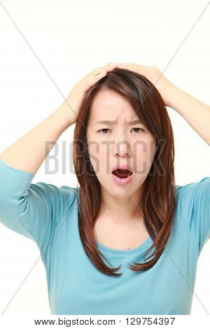 portrait of perplexed woman on white background