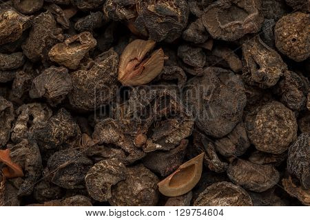 Organic dried Indian gooseberry (Phyllanthus emblica) with whole seeds. Macro close up background texture. Top view.