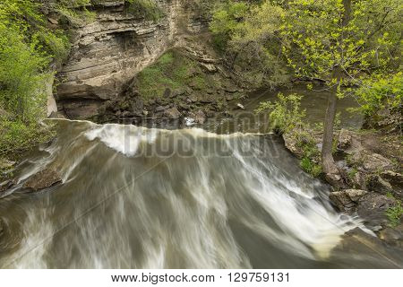 A river falling over a ledge during spring.