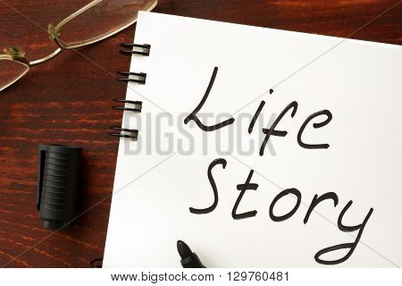 Life story sign written in a notepad.