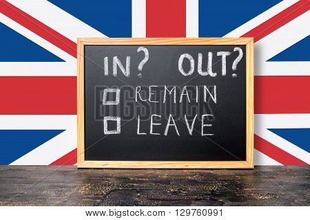 Brexit UK EU referendum concept with flag and handwriting text in out leave remain is written in chalkboard close up poster