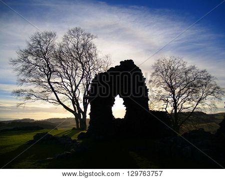 Scottish castle ruin sunset silhouette, Perthshire Scotland