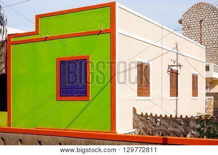 SANTA MARIA CAPE VERDE - DECEMBER 17, 2015: Colorful architecture of Cape Verde orange green residential house