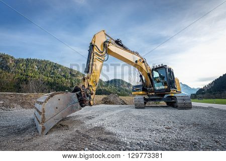 huge heavy shovel excavator digger on gravel construction site