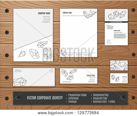 Corporate identity template geometric polygonal crystals in mono line style. Corporate identity design. Corporate identity vector. Corporate identity mock ups. Corporate identity on wooden planks.
